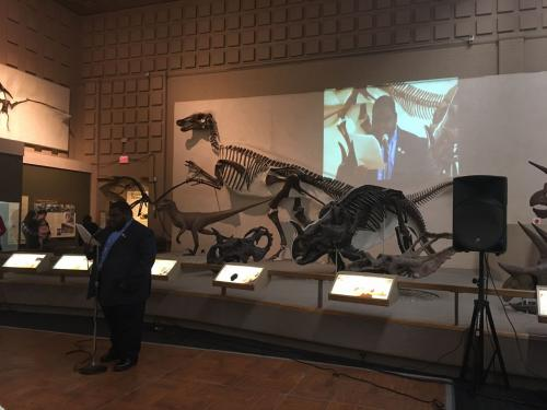 EVO student Wayde Whichard delivers another speech in the Great Hall of Dinosaurs.