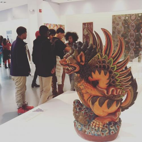 Students discuss anthropology in front of a winged lion (singa) from Indonesia.