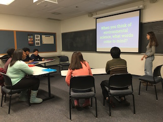 EVO instructor and Environmental Studies major Arabelle leads the group in discussing prior knowledge of environmental science during the February workshop.